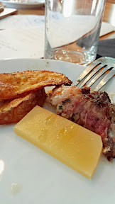 Mediterranean Exploration Company, Greek Potatoes, a little sample of Steve's Cheese Board, and a piece of the Dry aged Rib Eye with baharat, red chili, pine nut butter