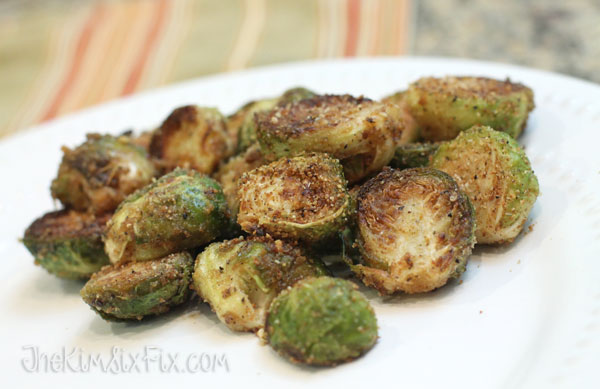 Crispy Parmesan Crusted Brussels Sprouts: An easy recipe since you par-bake the sprouts in the oven and finish them on the stove. No need to watch them they entire time. The crispy bread cumbs and salty cheese is a perfect addition to the soft savory Brussels Sprouts. #TheKimSixFix