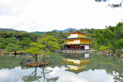 We go through a gate and suddenly BAM this is the view - the famous main pavilion is covered in gold leaf and shimmers in front of a pond - Kyoko-chi (Mirror Pond) at Kinkakuji (Golden Pavilion) in Kyoto. This pavilion and pond take up 93,000 of the 132,000 square meter temple grounds