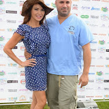 WWW.ENTSIMAGES.COM -     Lizzie Cundy  and  Marc Abraham (TV Veterinary Business Development and Coaching Consultant)    at       Pup Aid at Primrose Hill, London September 6th 2014Puppy Parade and fun dog show to raise awareness of the UK's cruel puppy farming trade. Pup Aid, the anti-puppy farming campaign started by TV Vet Marc Abraham, are calling on all animal lovers to contact their MP to support the debate on the sale of puppies and kittens in pet shops. Puppies & Celebrities Return To Fun Dog Show Fighting Cruel Puppy Farming Industry.                                              Photo Mobis Photos/OIC 0203 174 1069