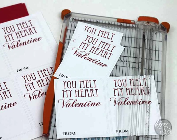 Cutting school valentines with paper cutter