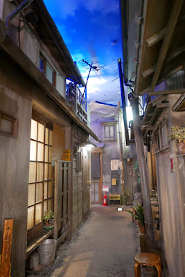 Inside the Shin-Yokohama Raumen Museum, featuring a streetscape like it's 1958 there are even sound effects on loundspeakers of monks chanting, or a cat meowing, or movies or radio music from the era, as you walk down the fake alleys of a neighborhood of homes and bars