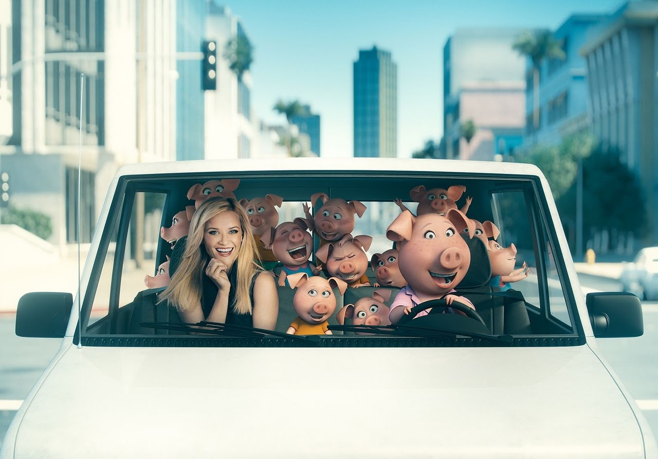 Reese Witherspoon with her SING character, Rosita, and her piglets. (Photo courtesy of Illumination Entertainment and Universal Pictures).
