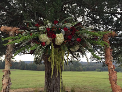 wedding arbor with fresh flowers