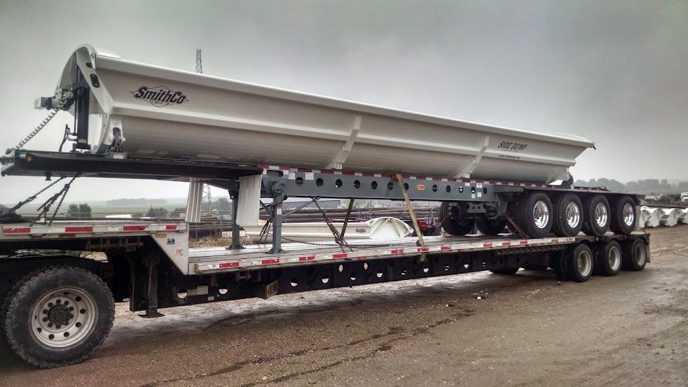 flatbed trailer loaded on a flatbed trailer