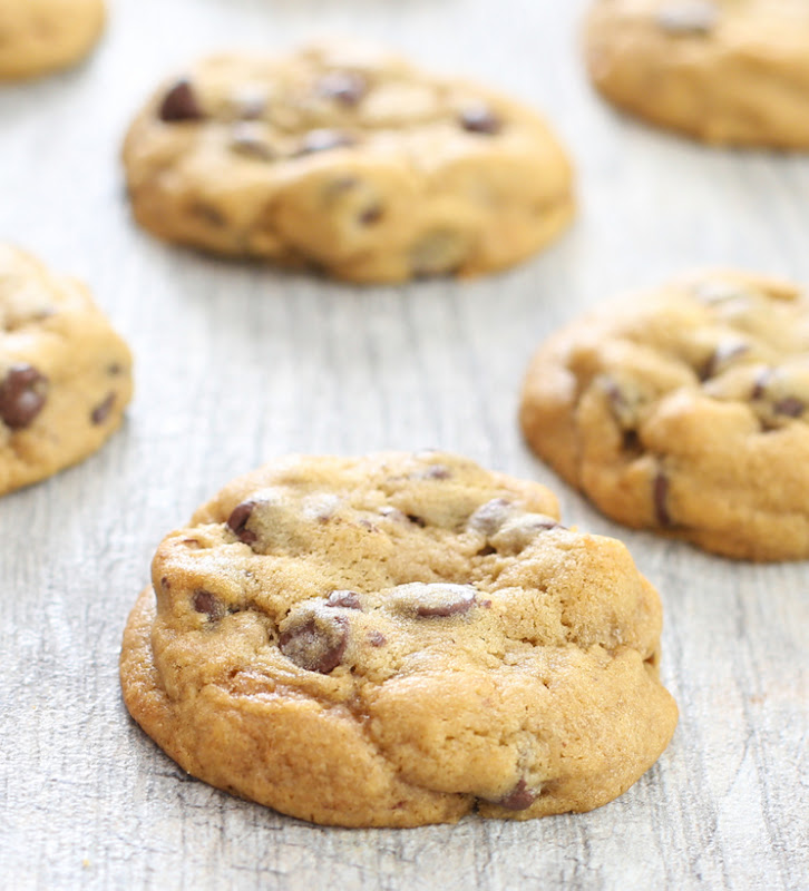 close-up photo of chocolate chip cookies lined up on a board