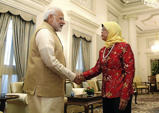 Indian Prime Minister Narendra Modi meets Singaporean President Halimah Yacob at the Istana, the presidential residence, in Singapore on June 1 2018. Picture: REUTERS