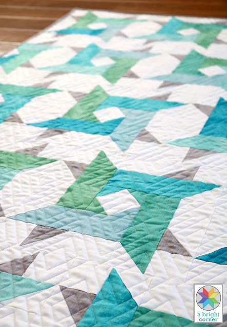 Windy City pattern by Andy of A Bright Corner is a modern twist on a star quilt.  Pre-cut friendly and perfect for using jelly roll strips, layer cake squares, fat quarters, or yardage. Has four size: crib, throw, twin, queen