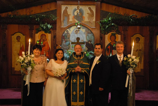 Fr. John with the bride and bridegroom, and their sponsors.