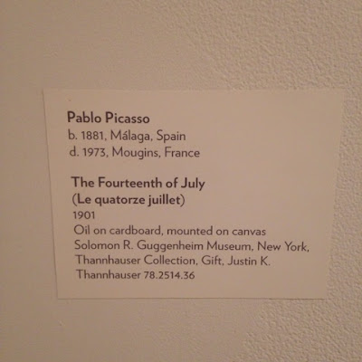 The museum tag for Le quatorze juillet by Pablo Picasso at the Guggeneheim in NYC