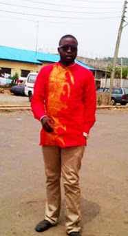 male in red shirt with golden embroidery