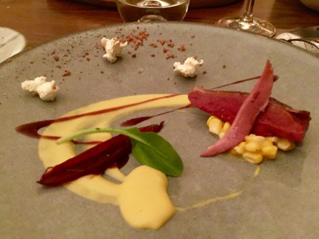 Anjou pigeon, chargrilled, sweet corn, shallot, bacon popcorn, red wine essence in Texture restaurant in London
