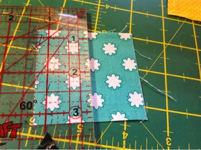 """cut 2.5"""" squares in half"""