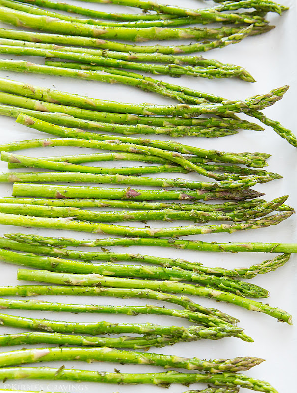 process photo showing prepped asparagus on a baking sheet
