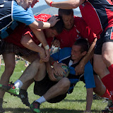 A ruck develops as VMI (blue and navy) attempted to drive towards the goal during their final match on Sunday.