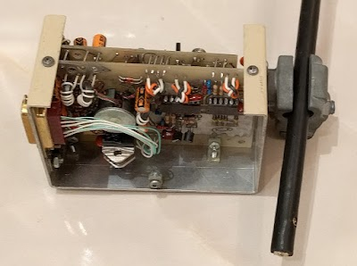 "Inside a transceiver box. The ""vampire tap"" on the right connects the transceiver to the Ethernet cable. The connector on the left goes to the Alto."
