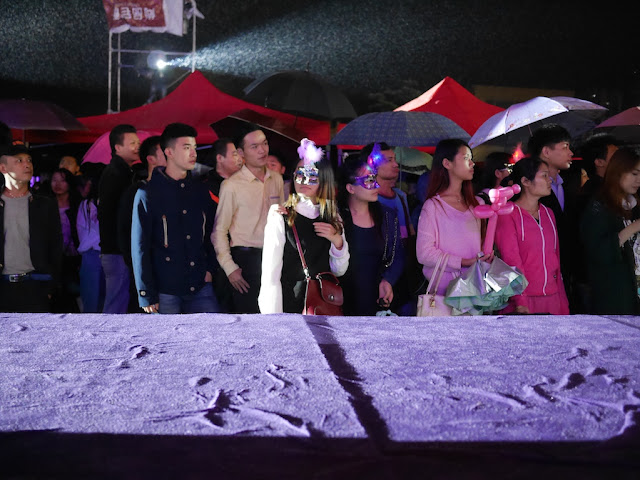people watching the dancing at the Halloween 2 party in Shaoguan