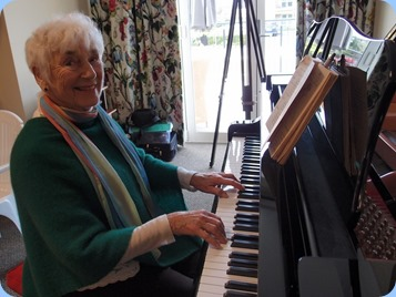 Audrey Henden playing the grand piano. Photo courtesy of Dennis Lyons.