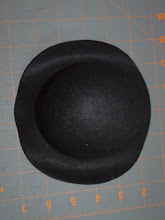 Photo: The first step is to spritz water on the brim of the hat.   Spritz the top and the bottom of the brim, all the way around and let it sit a few minutes.  Repeat this step 1 or 2 more times, until the brim is soft and flexible.  Don't over saturate it!  Moist is good.  Wet and soggy is bad and makes it hard to work with.  If it gets too wet, let it dry a few minutes before you continue.  Try not to get the crown (top) of the hat wet.  You don't want that to loose it's shape.