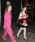 Cindy Lou Who follows a Mrs. Claus wannabe to the bus.