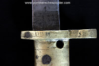 """Stamp of letter """"M"""" on the brass ersatz handle"""