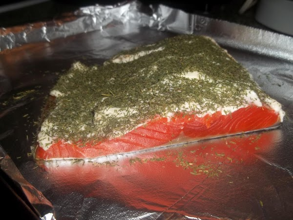 SPRINKLE DILL WEED OVER TOP COVERING ALL OF SALMON.