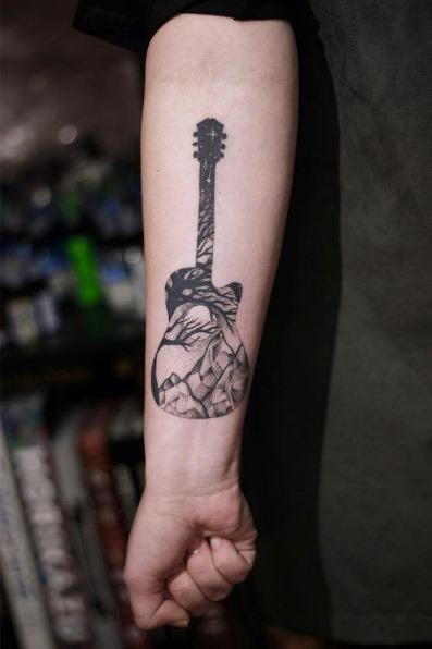 esta_dupla_exposiço_guitarra