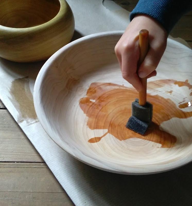 Ahren oiling a pine bowl