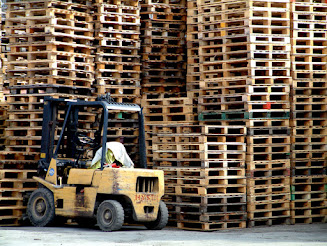 Forklift operator was injured at work, is his employer liable. What are compensation he can receive, can he file charges