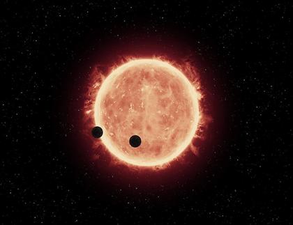 ilustração de dois exoplanetas passando em frente da sua estrela hospedeira