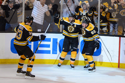 Zdeno Chara, Patrice Bergeron and Brad Marchand celebrate the overtime winning goal scored by Bergeron