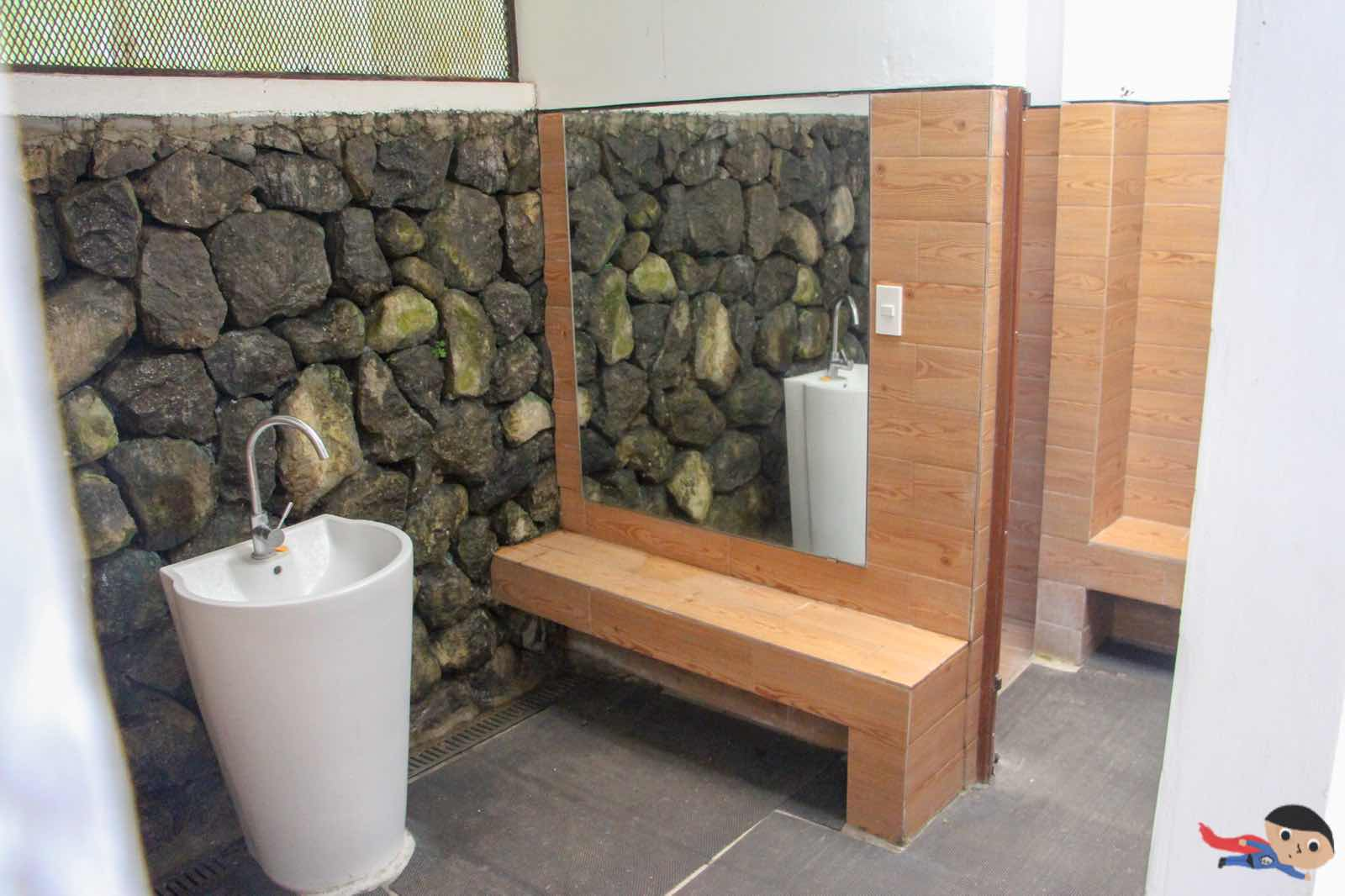 Shower area and toilet in the pool side of Jamaica Peak Resort