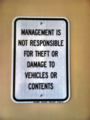 management disclaimer sign parking theft damage stock photo