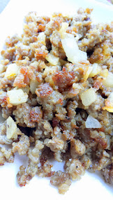 Crumble and cook breakfast sausage with minced onion