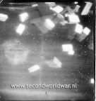 10 in 1 rations are falling from the belly of a B-17, food dropped for the dutch during operation chowhound