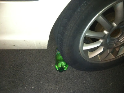 soda,bottle,car,tire,joke,explosion