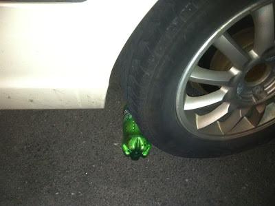 soda,bottle,car,tire,joke,explosion