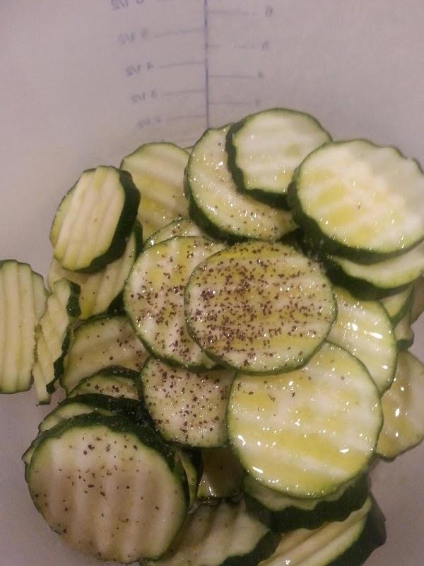 Toss zucchini in olive oil, salt, pepper and garlic