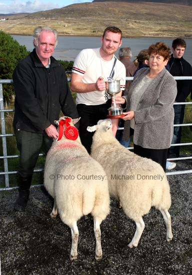 Maureen Johnston, Westport/Cloughmore presents the Thomas Johnston Cup to John and Edward Fadian, Dookinella  for best pen of 2 Crossbred Ewes (Open) at the 21st Achill Sheep Show (Taispeántas Caorach Acla 2007) at Pattens Bar, Derreens Achill. Photo: © Michael Donnelly