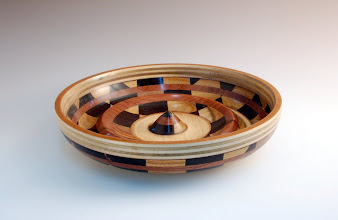 "Photo: Richard Webster - Segmented Bowl - 11 1/2"" x 3"" - Various woods (made from two checker boards)"
