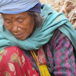 Woman in Salle weaving a mat