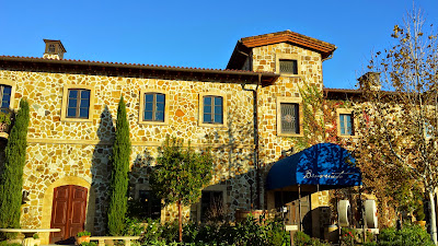The front of the building for the tasting room of Jacuzzi Family Vineyards
