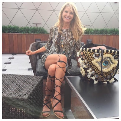 Christie Brinkley in Valentino Aphrodite Gladiator Sandals