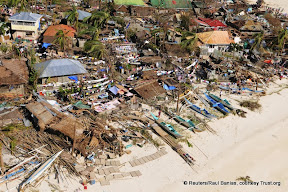 Arial view of damaged houses on coastline