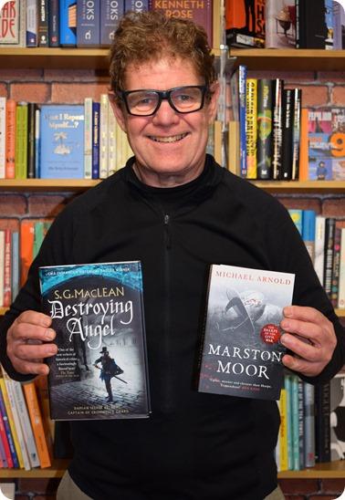 Steve Lawson from Nantwich Book Shop & Coffee holds books from authors attending the event