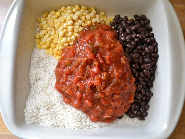 rice, corn, beans and salsa added to casserole dish