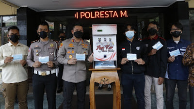Pertama di Indonesia, Polresta Malang Kota Luncurkan Dispenser Masker
