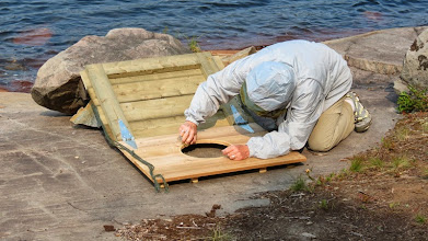 Photo: but first - another thunderbox installation - Jan sanding the seat area with a rock
