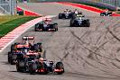 Pastor Maldonado, Lotus E22 Renault, leads Jean-Eric Vergne, Toro Rosso STR9 Renault