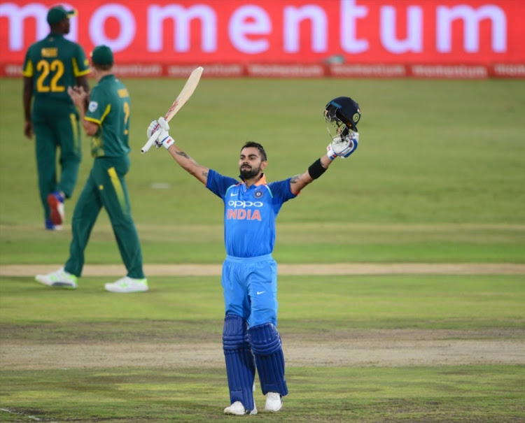 Virat Kohli of India celebrates his 100 runs during the 6th Momentum ODI match between South Africa and India at SuperSport Park on February 16, 2018 in Pretoria.